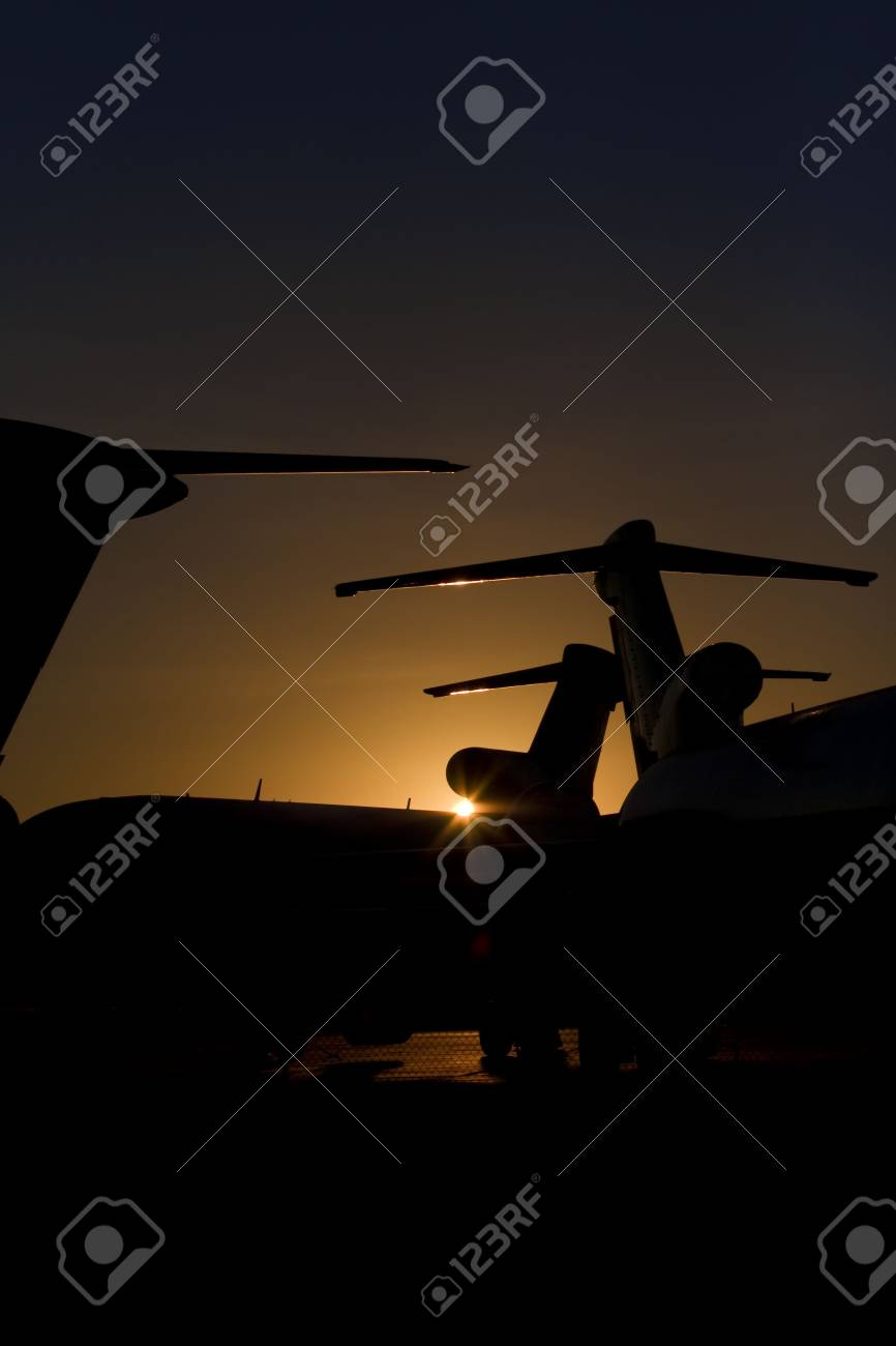 Commercial Airplanes In Sunrise Silhouette Stock Photo