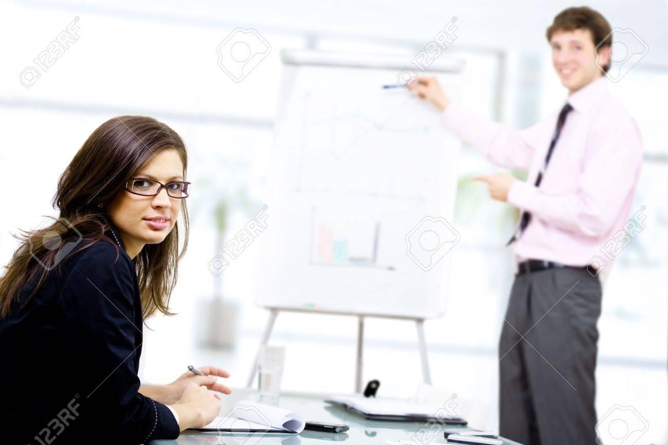 Youn businessman doing presentation on whiteboard. Stock Photo - 2139582