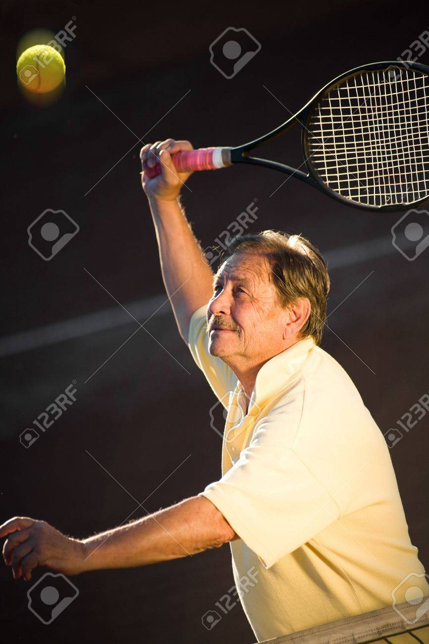 Active senior man in his 70s is playing tennis. Stock Photo - 2383425