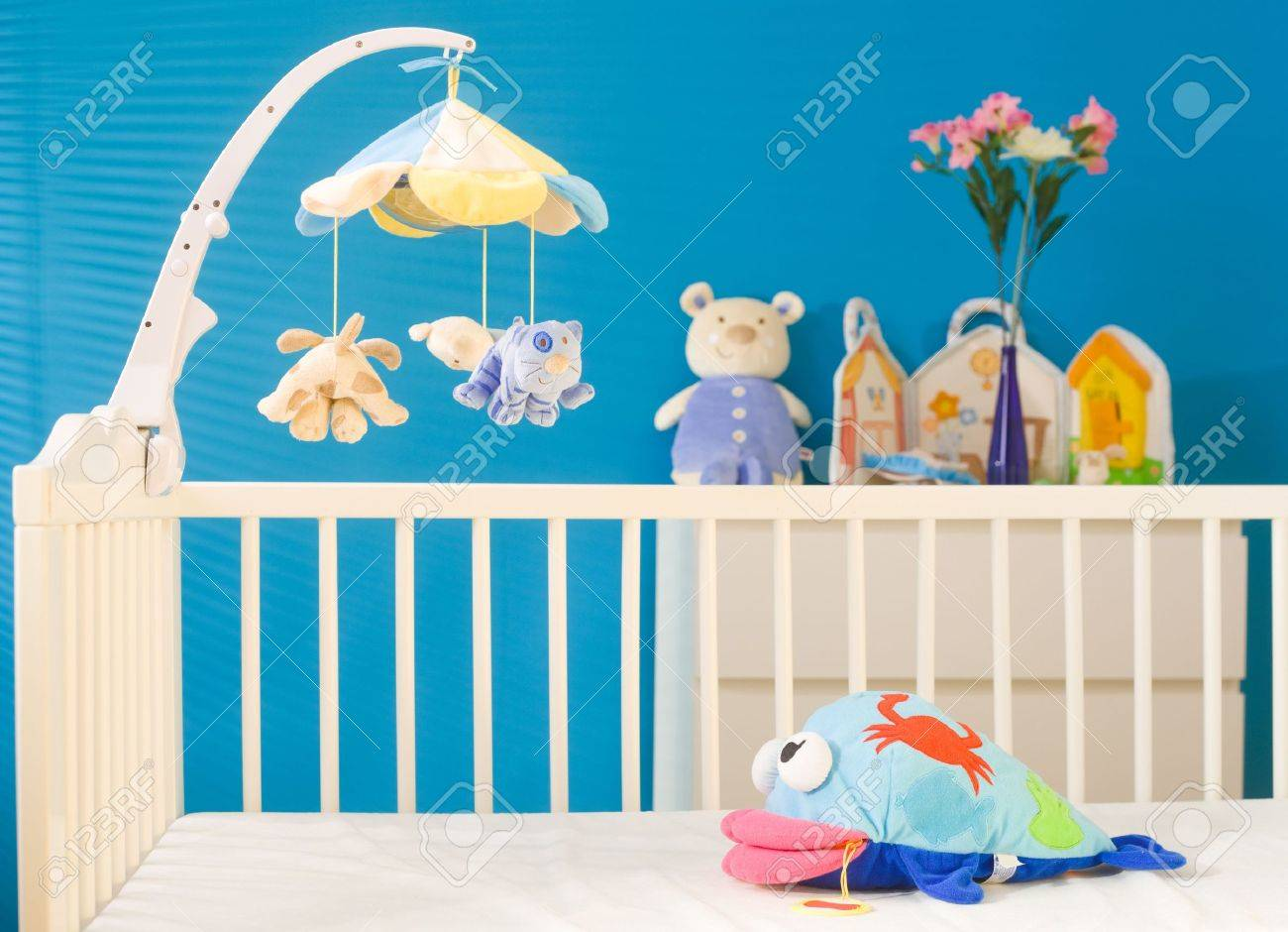 Crib and soft baby toys at children's room. Toys are officially property released. Stock Photo - 3199997