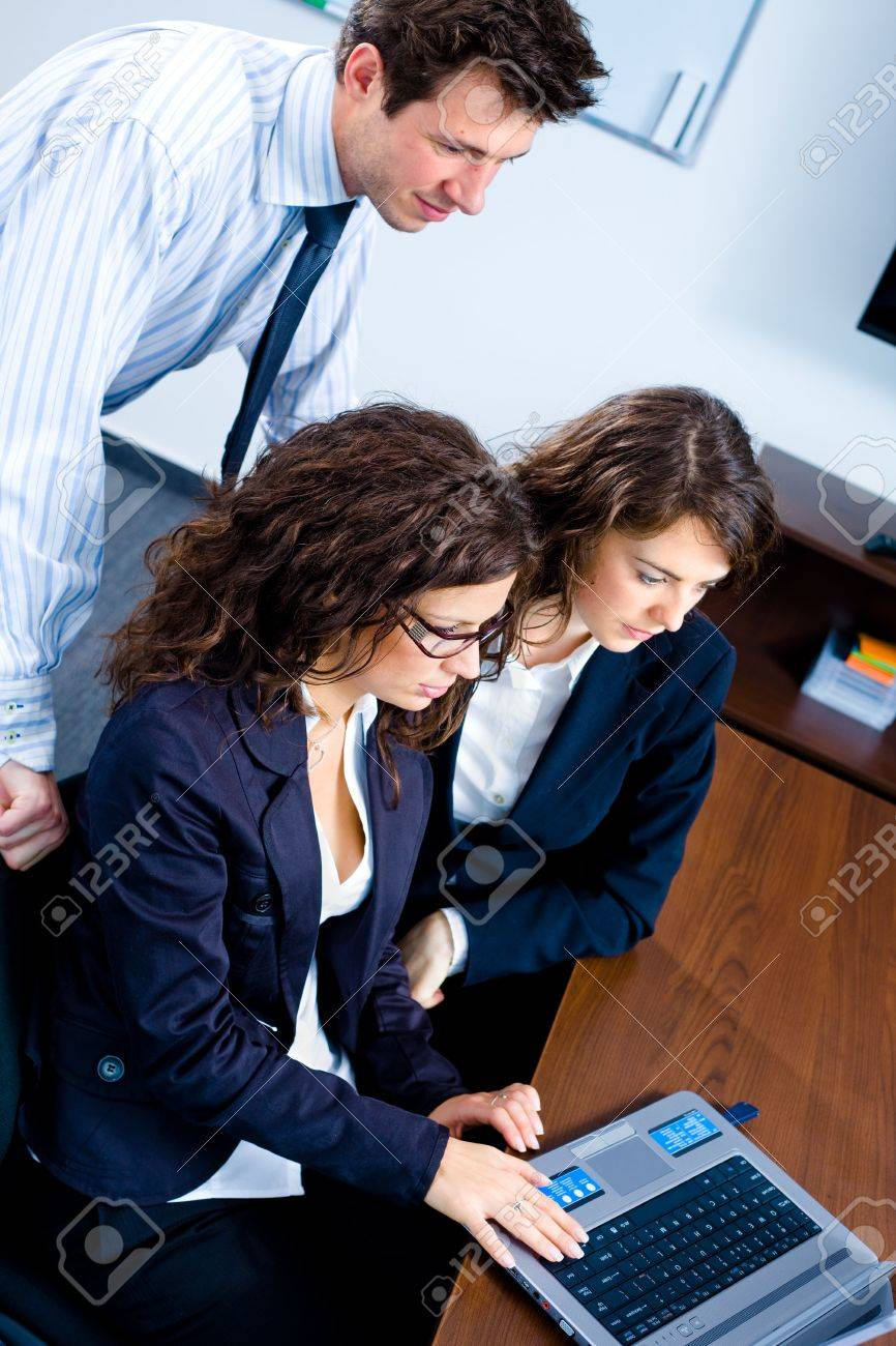 Young businesspeople working together in business team on laptop computer in meeting room at office. Stock Photo - 3868609