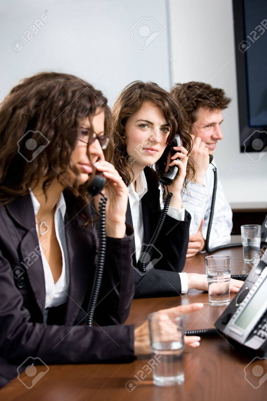 young customer service operator team working at office holding stock photo young customer service operator team working at office holding phone calling giving helpdesk support