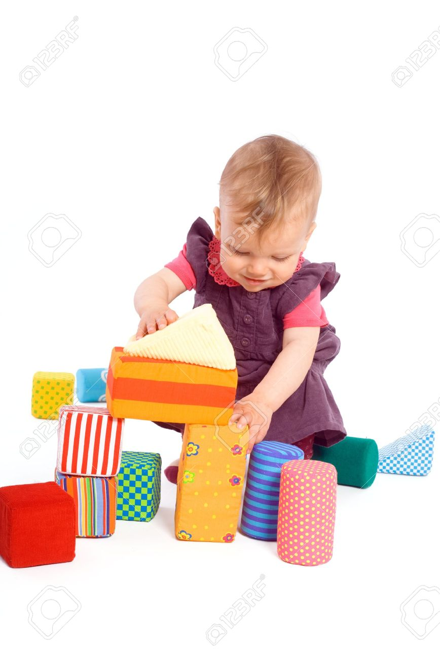 Cute Baby Girl 1 Year Old Playing With Toy Blocks Isolated