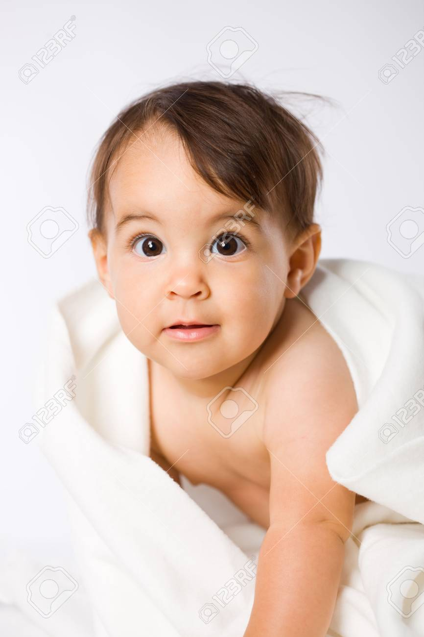 Portrait of 8 months old baby girl, white background. Stock Photo - 3889270