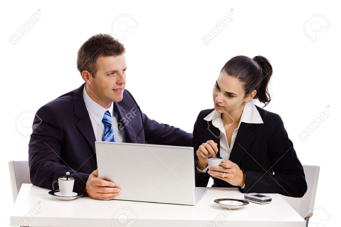 Business people working on laptop at desk, white background. Stock Photo - 3916165