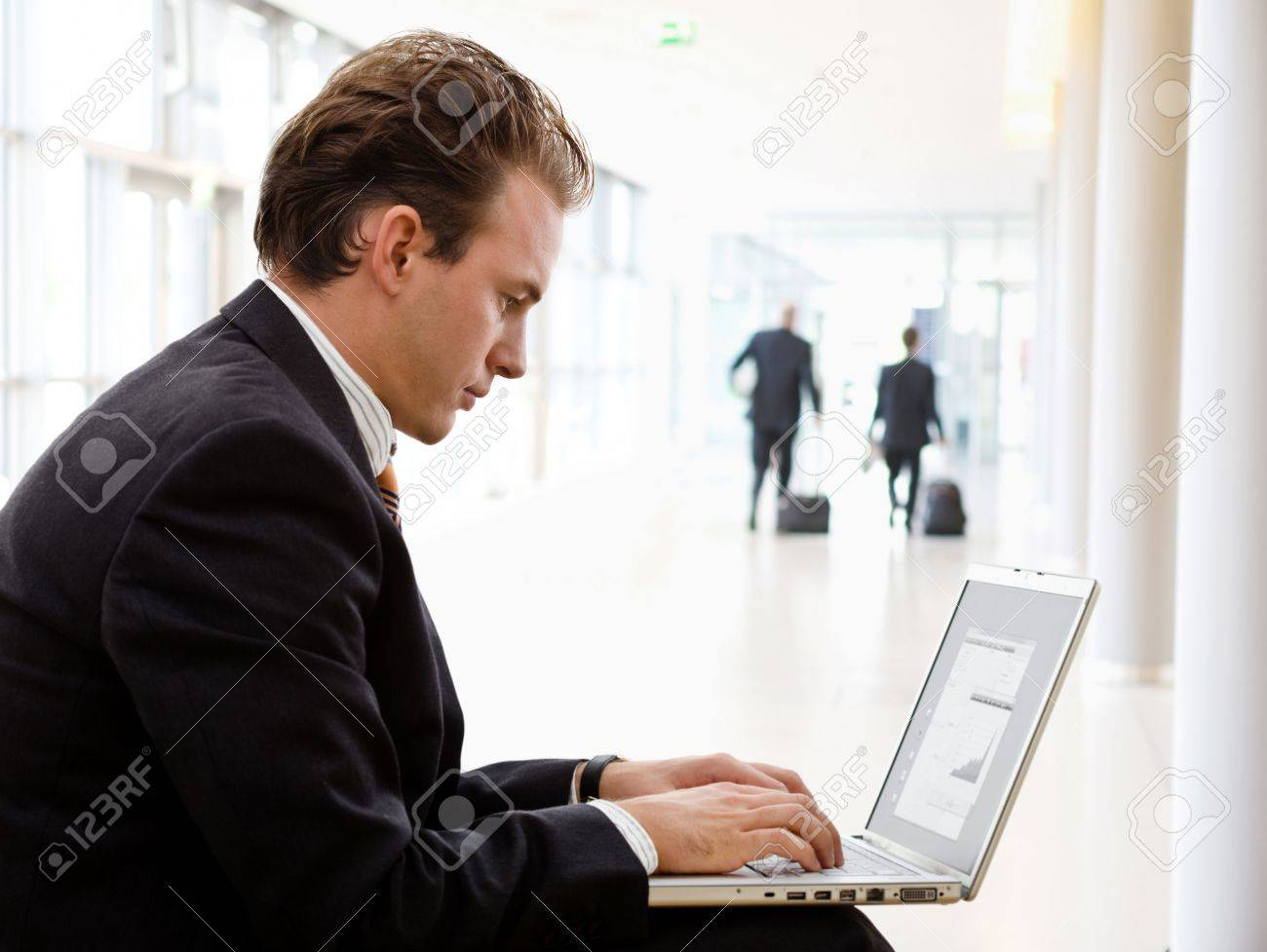 Businessman working on laptop computer at office lobby. Stock Photo - 3916195