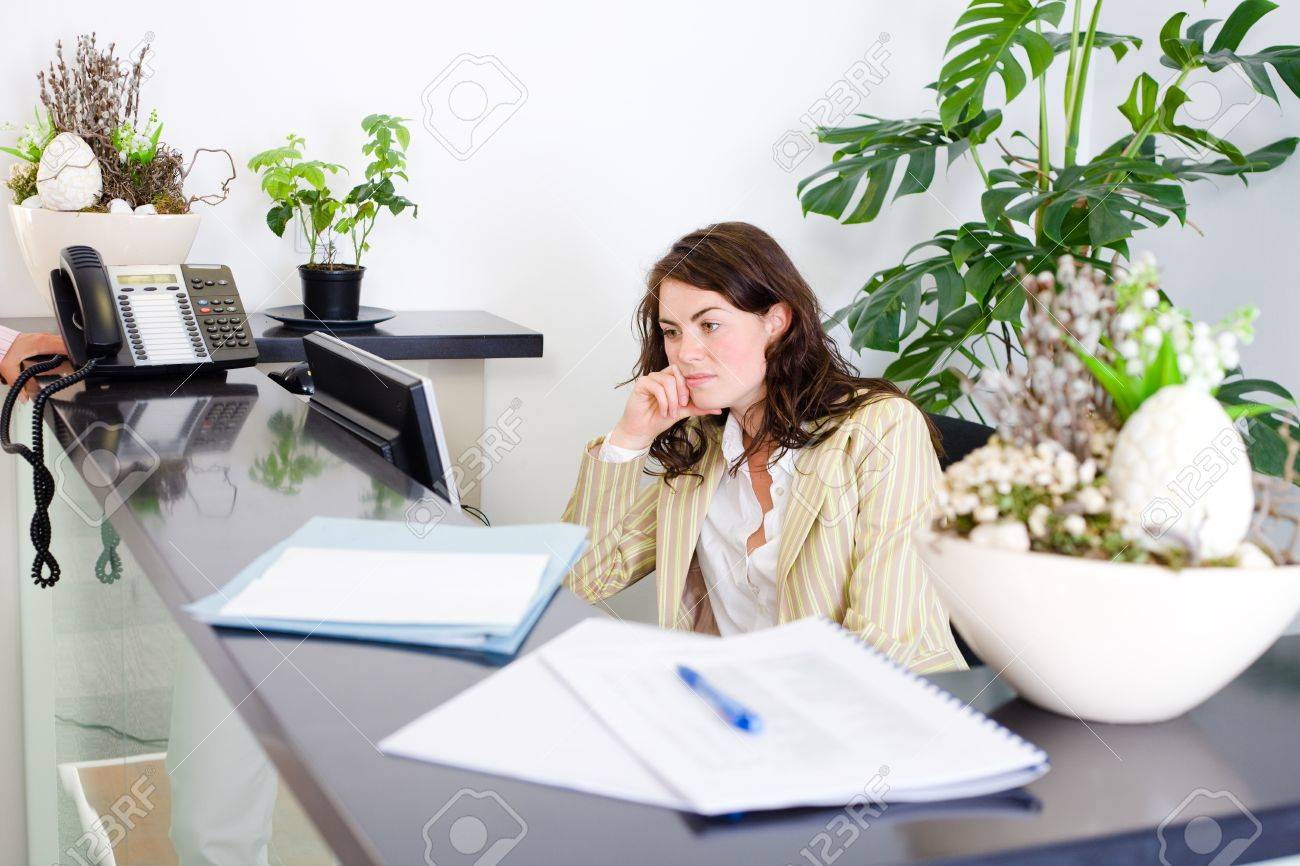 Young Female Office Receptionist Talking On Phone. Stock Photo ...