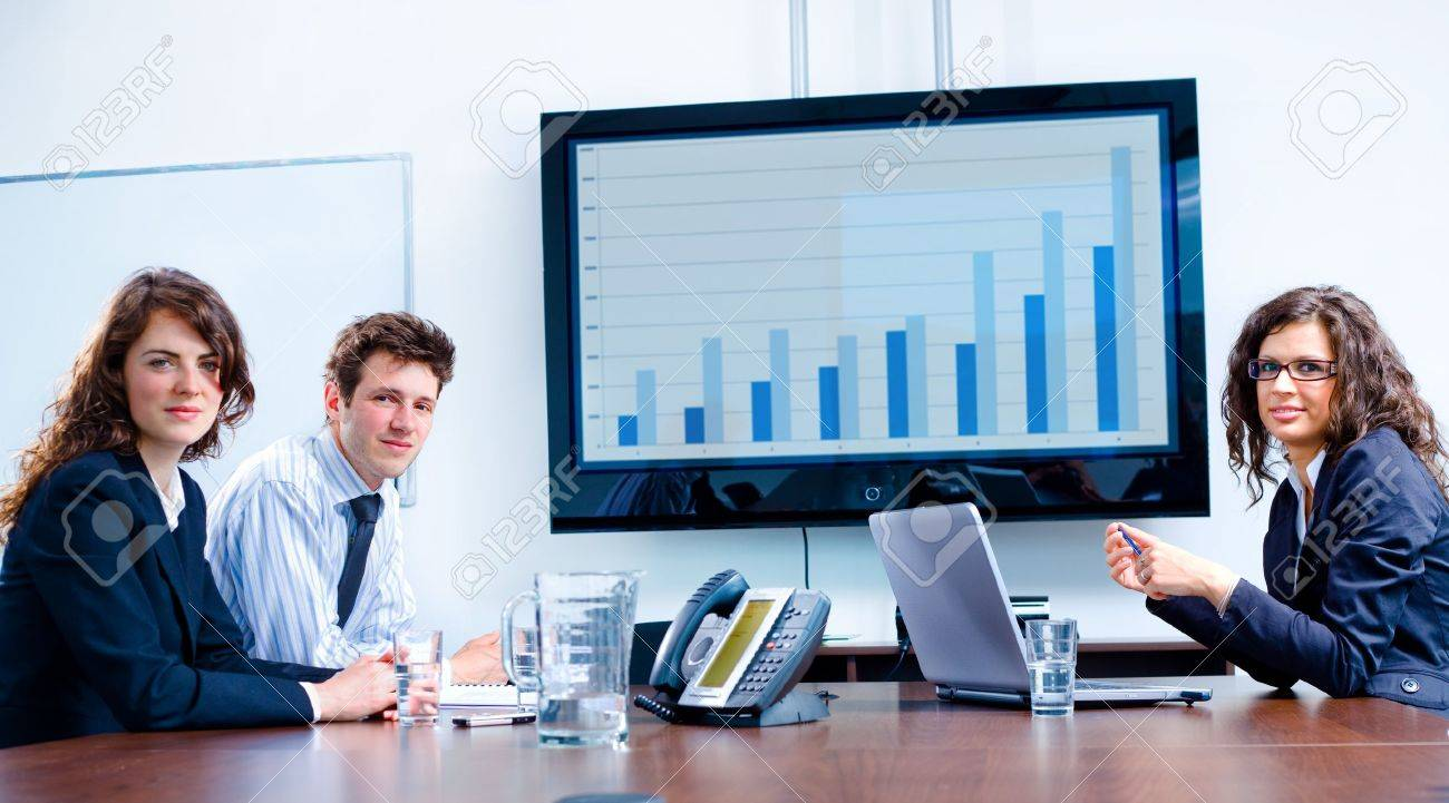 Happy business people having meeting at modern office, smiling. Stock Photo - 4105597