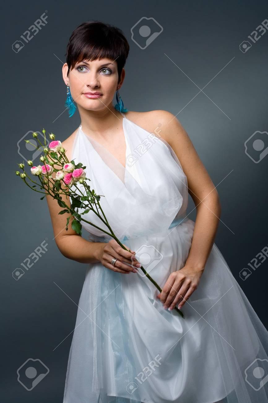 Studio portrait of mature caucasian bride wearing classic white wedding dress. Stock Photo - 4089945