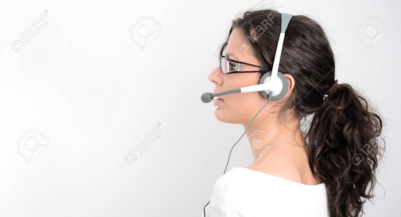 Pretty young woman works as a helpdesk operator. Stock Photo - 4100522