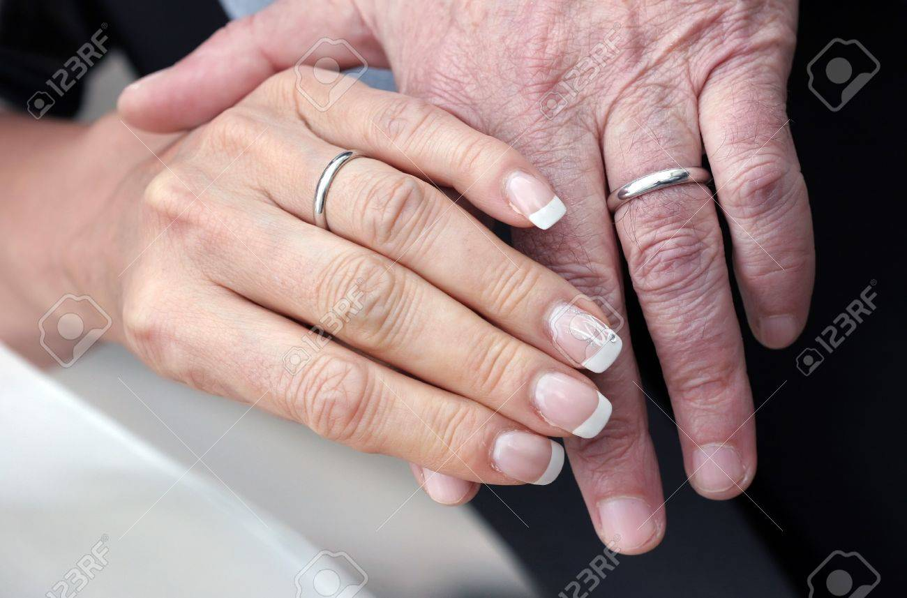 Hands Of An Aged Couple Who Still Wear Their Wedding-rings As ...