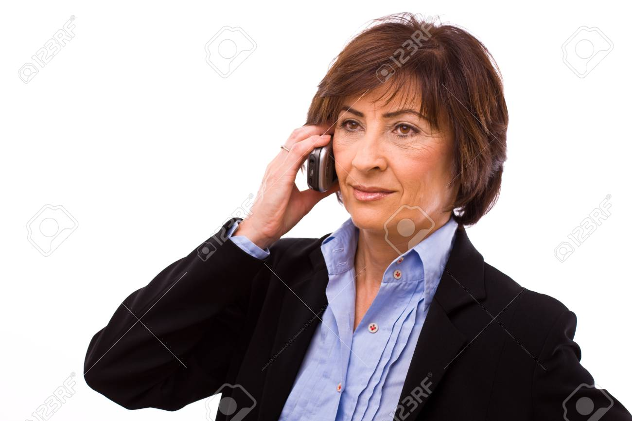 Senior businesswoman calling on mobile phone isolated on white background. Stock Photo - 4130731