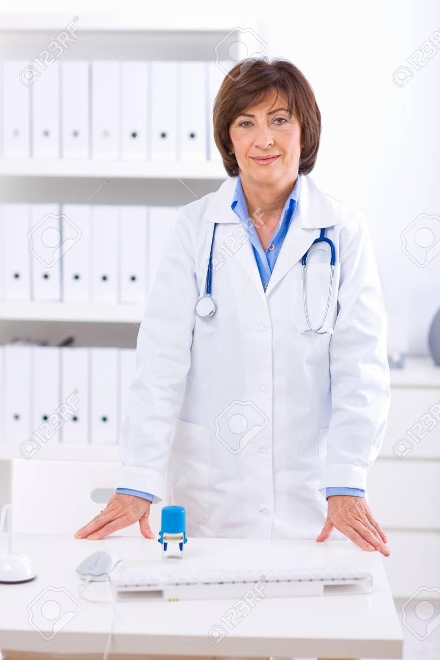 Portrait of senior female doctor working at office. Stock Photo - 4161068