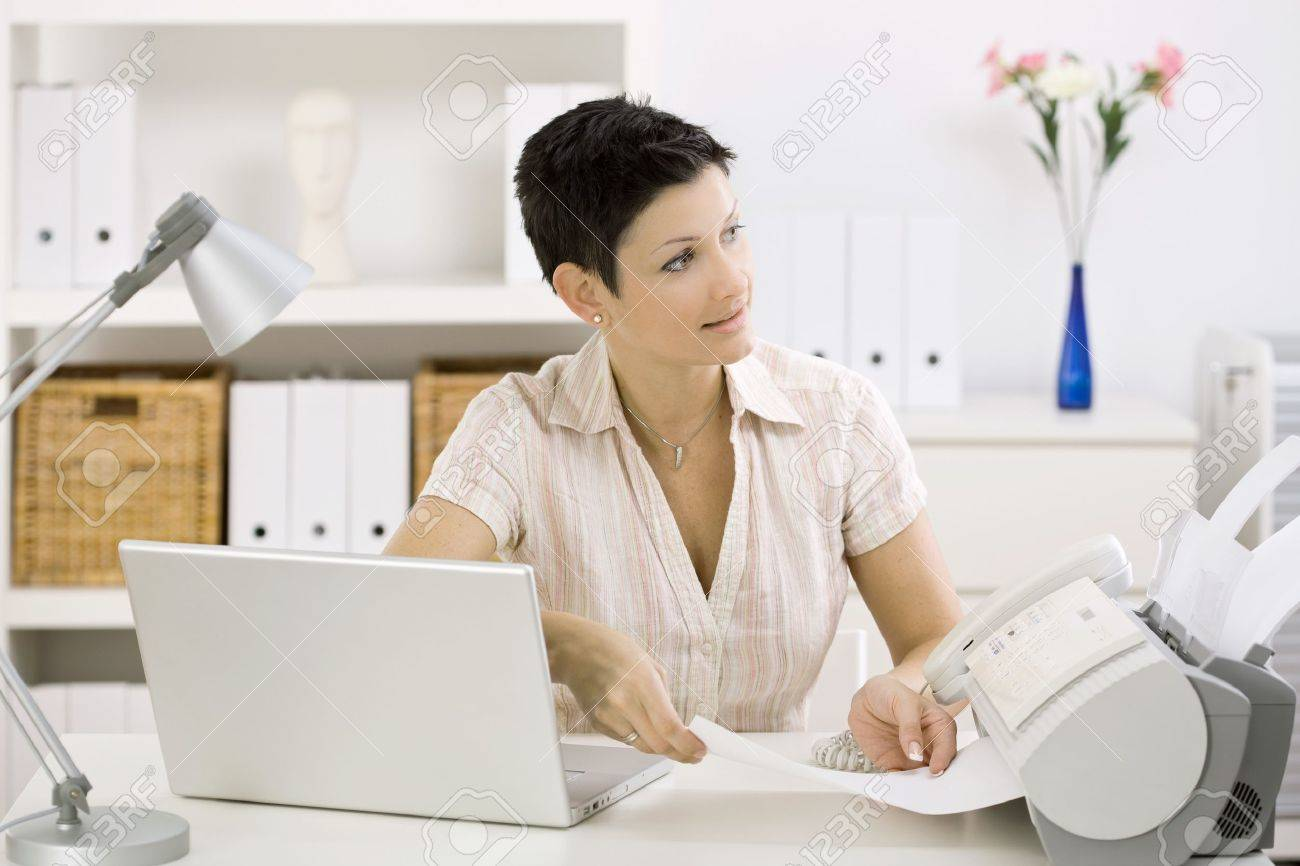 Amazing Woman Using Fax Machine At Home Office Stock Photo Picture And Largest Home Design Picture Inspirations Pitcheantrous