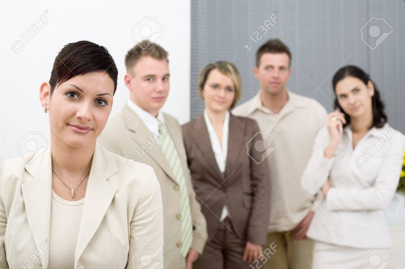 Young office workers standing side by side at office. Stock Photo - 4193318