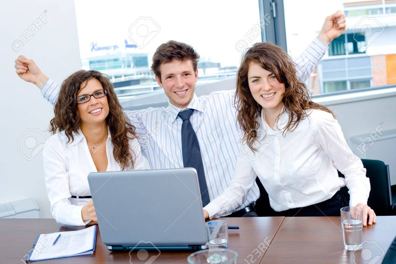 Happy successful business people sitting on meeting at office, working on laptop computer, smiling. Stock Photo - 4193370