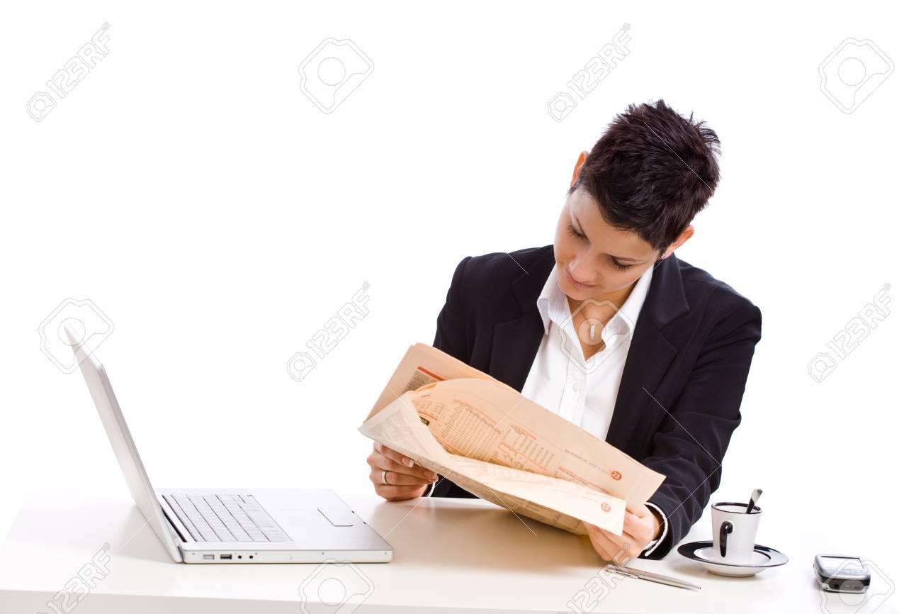 Businesswoman reading financial newspaper, white background. Stock Photo - 4366399