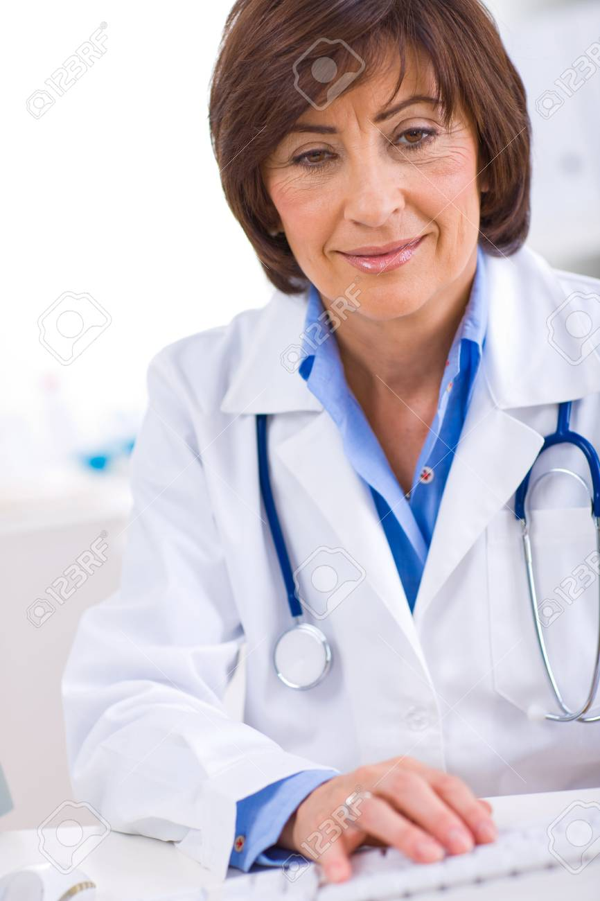 Senior female doctor working on computer at offiice. Stock Photo - 4720097