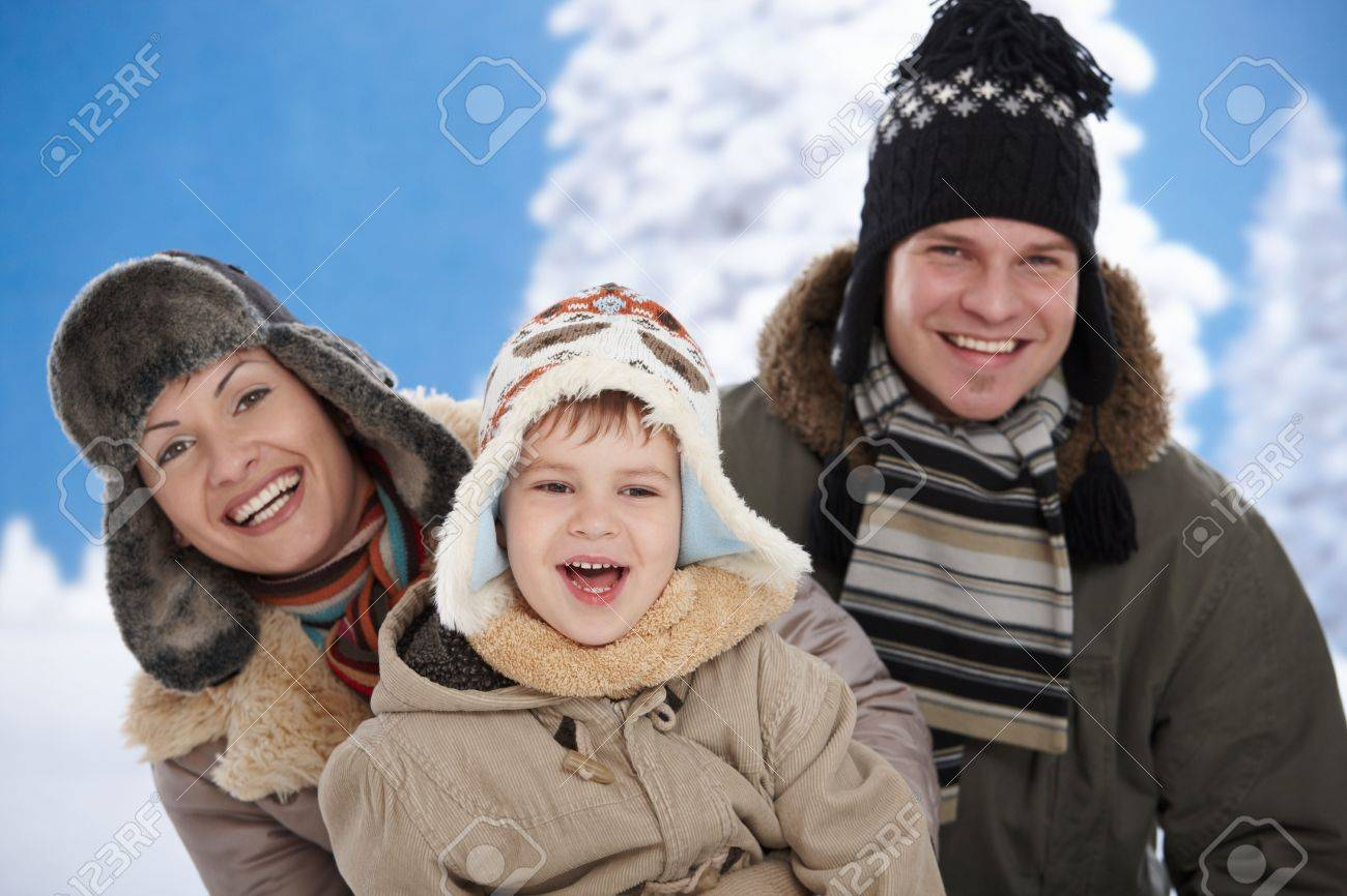 Portrait of happy family together outdoor in snow on a cold winter day, laughing, smiling. Stock Photo - 5806437