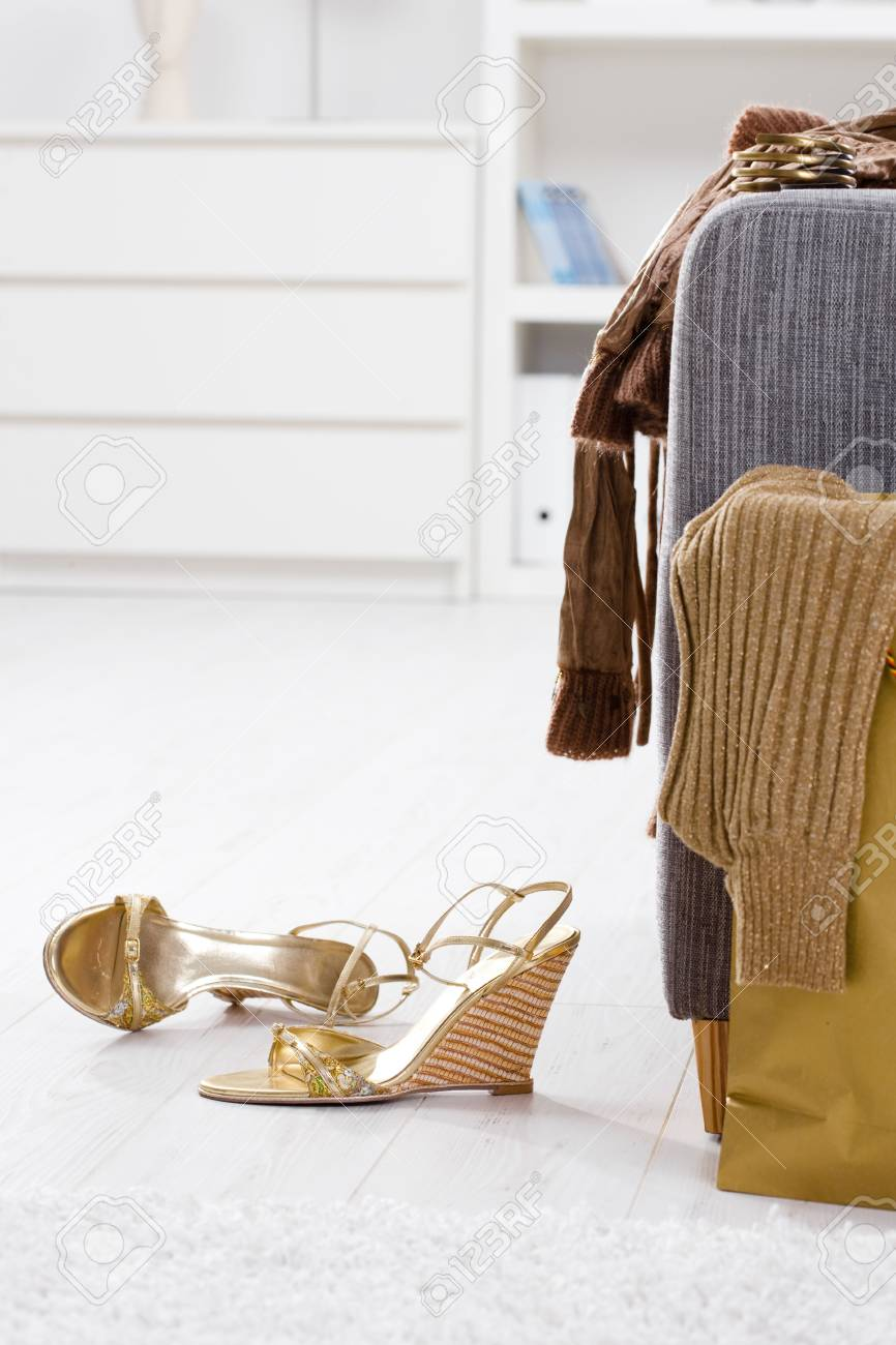 Newly bought femal clothes and shoes packed out at home. Stock Photo - 5932512