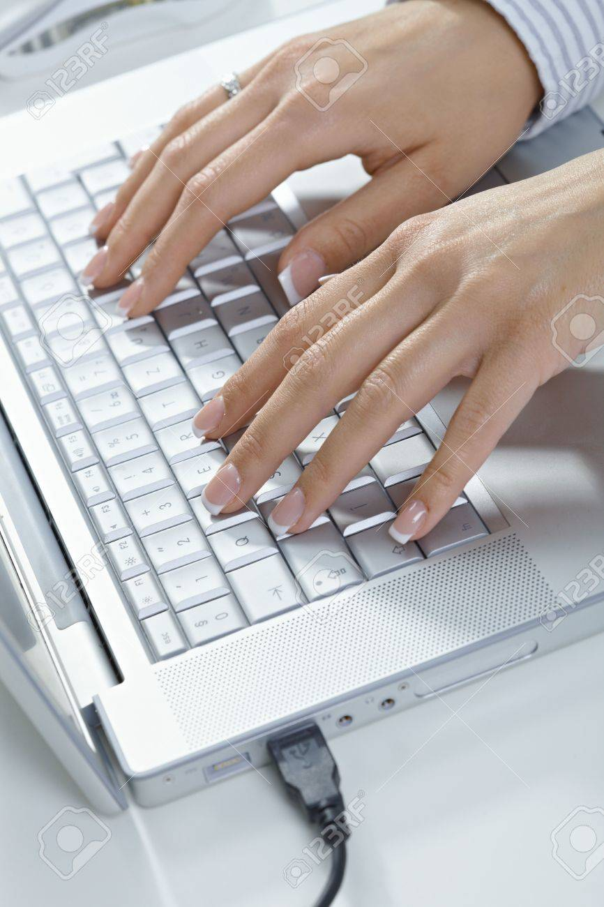 Closeup picture of female hands typing on laptop computer keyboard. Stock Photo - 5932544