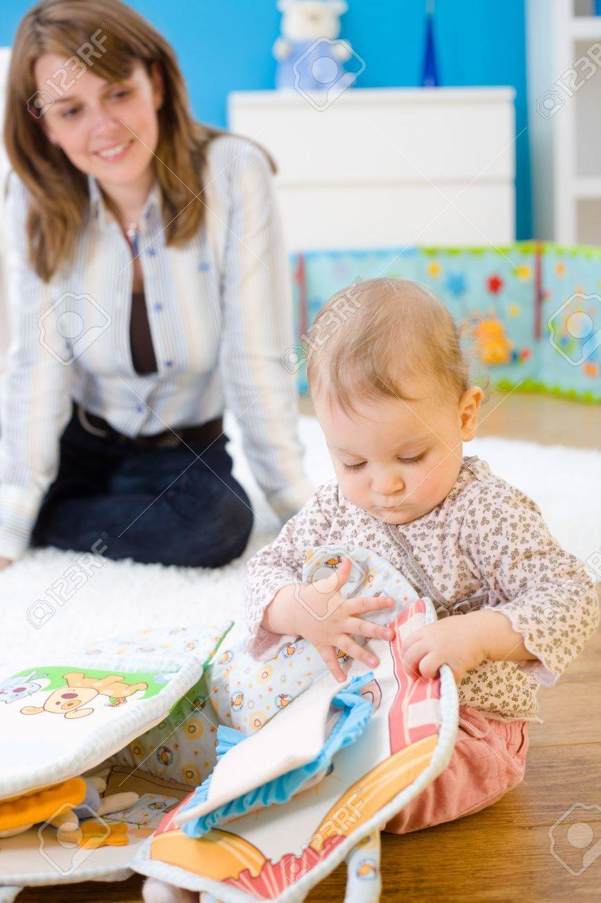 Mother and baby girl (1 year old) playing on floor at home. Stock Photo - 5943613
