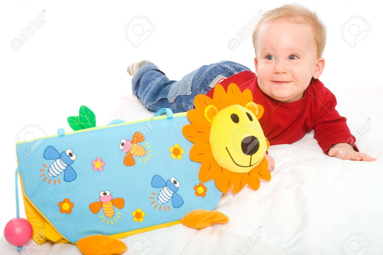 Happy Baby Boy 6 Months Old Playing With Soft Toys Smiling