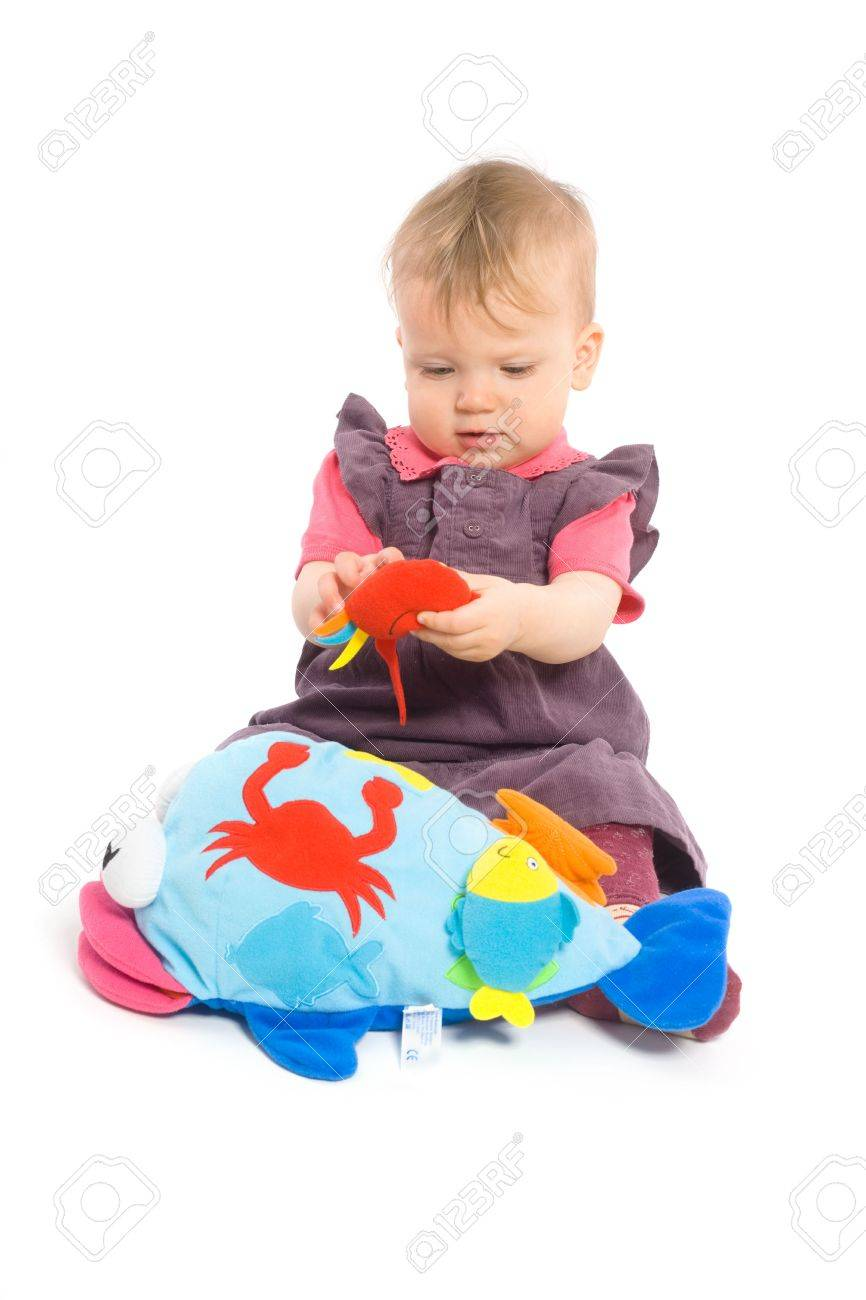 Cute Baby Girl 1 Year Old Sitting On Floor Playing With Stuffed
