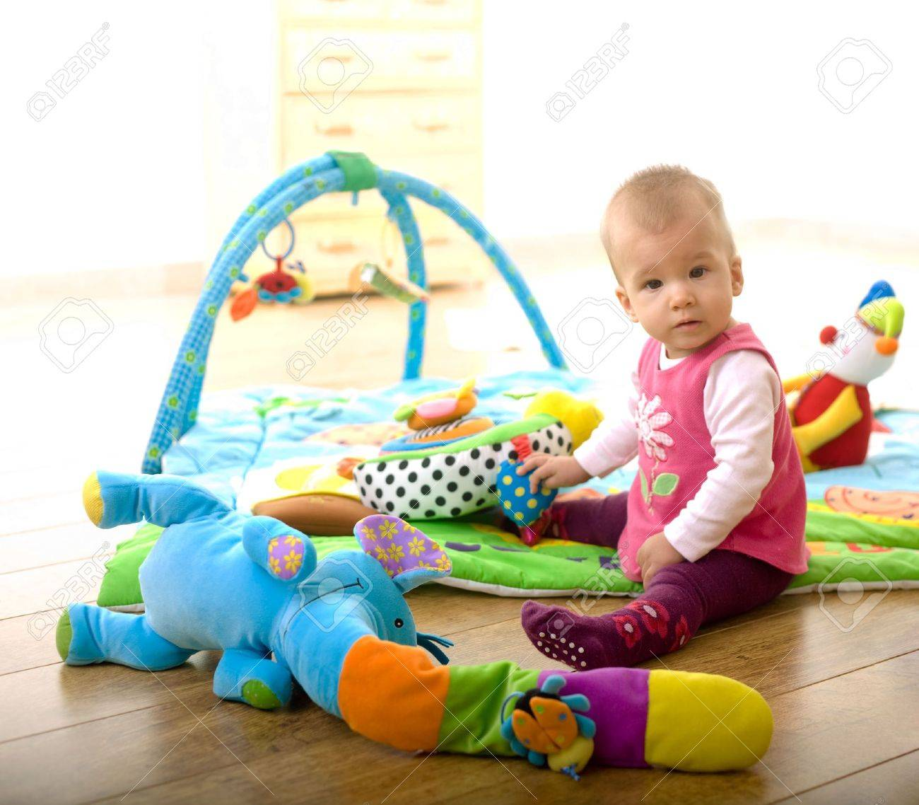 Baby Girl 9 Months Old Sitting On Floor And Playing With Toys - 9-month-old-baby-toys