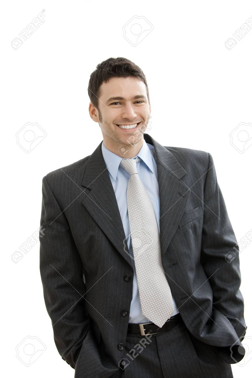 Happy businessman standing with hands in pocket, looking at camera, smiling. Isolated on white background. Stock Photo - 5982983