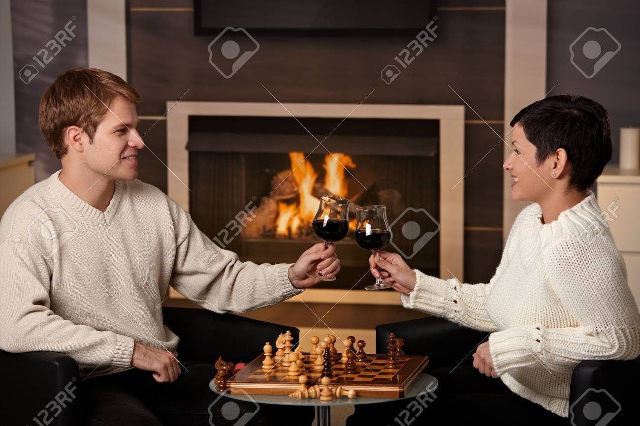 Young couple playing chess at home on a cold winter day. Stock Photo - 5983171
