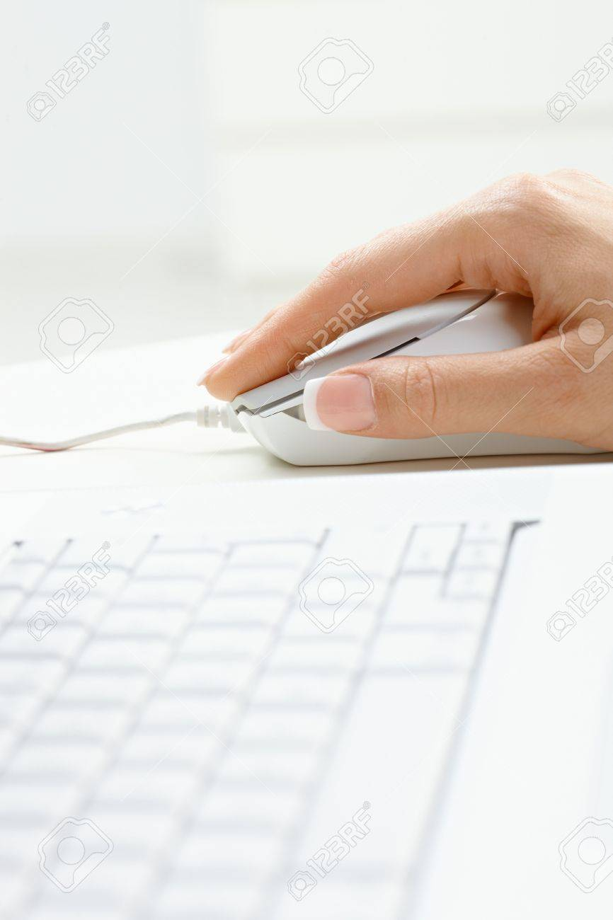 Closeup picture of computer keyboard and female hand using mouse. Stock Photo - 6285701