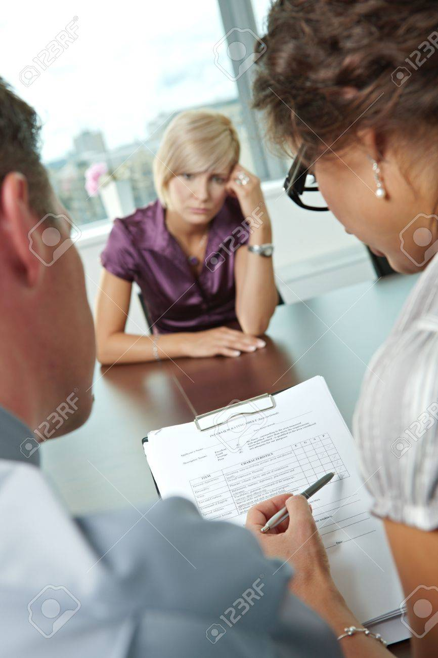 w applicant having failed job interview over the shoulder stock photo w applicant having failed job interview over the shoulder view focus placed on sheet in front all results are bad