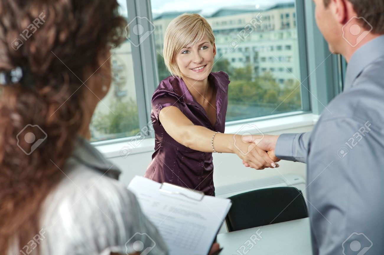 Business people shaking hands over meeting table at office, smiling. Stock Photo - 6285858