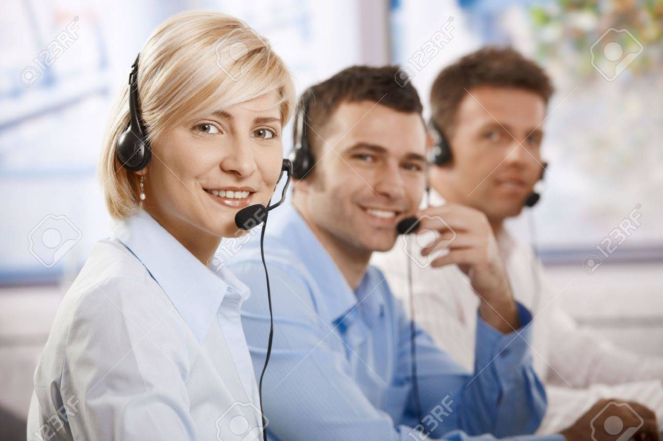 Happy young customer service operators talking on headset, looking at camera, smiling. Stock Photo - 6373727