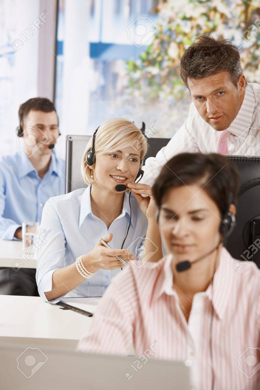 Manager controlling customer service operators in office. Stock Photo - 6374113
