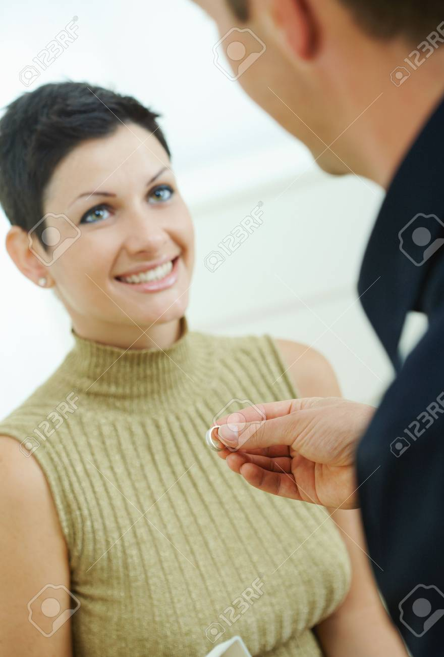 Man making a proposal giving engagement ring to her fiencee. Stock Photo - 6463551