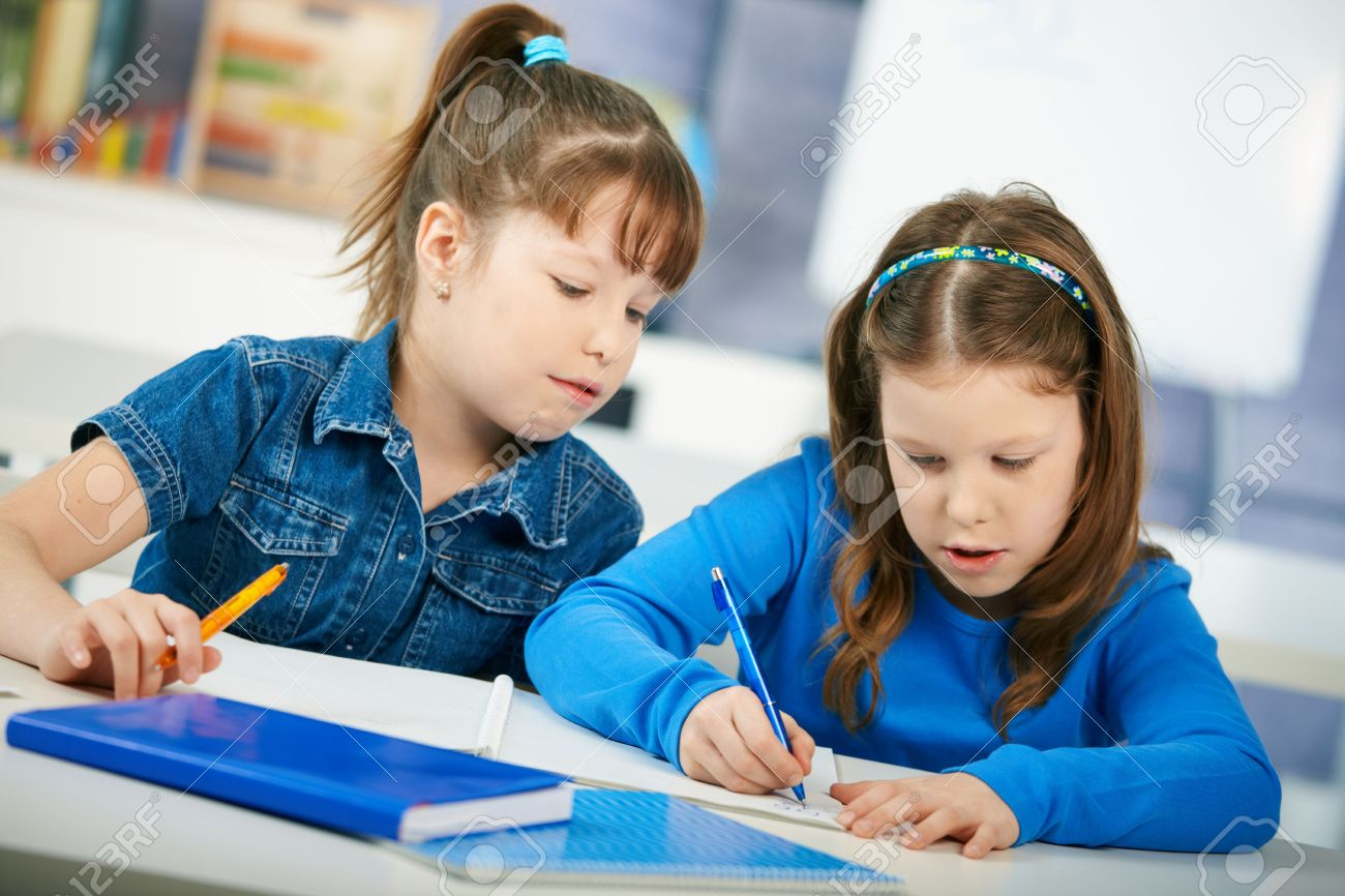 Schoolgirls learning together in primary school classroom. Elementary age children. Stock Photo - 6463935