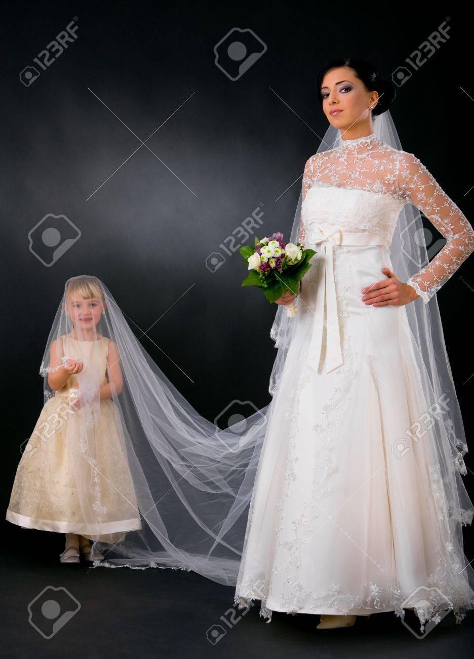 Bride Posing In Romantic White Wedding Dress Holding Bouquet