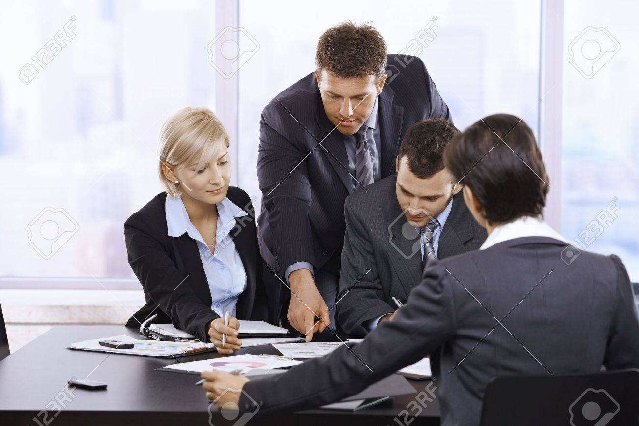 Busy business team working together, thinking at office meeting. Stock Photo - 6527331