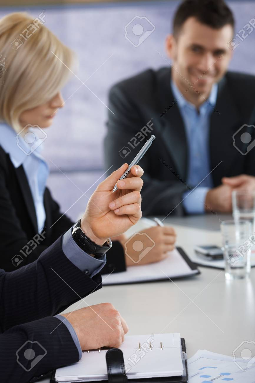 Closeup of hands on business meeting at office, businessman pointing with pen. Stock Photo - 6527152