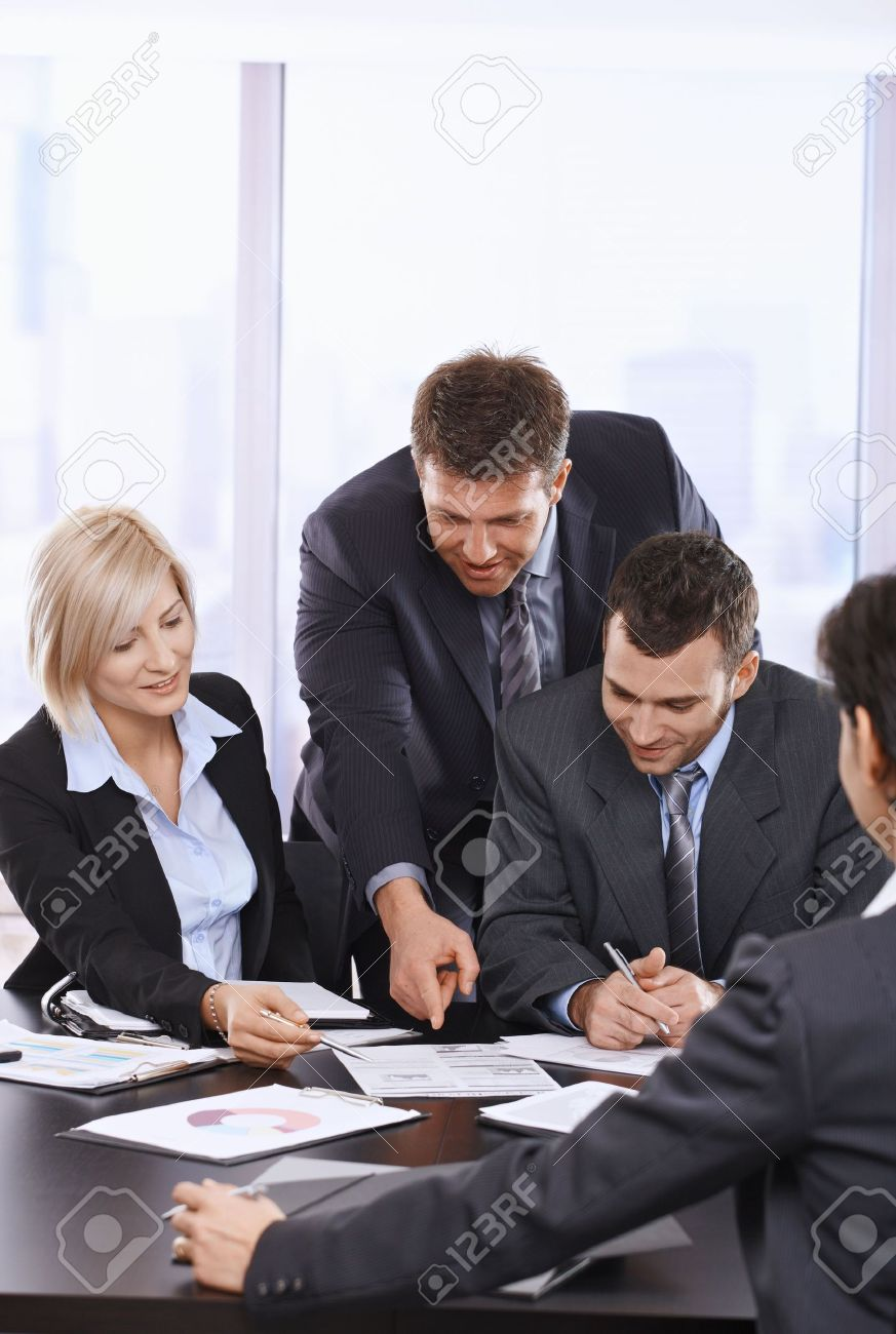 Busy business people working together, talking on office meeting. Stock Photo - 6578938