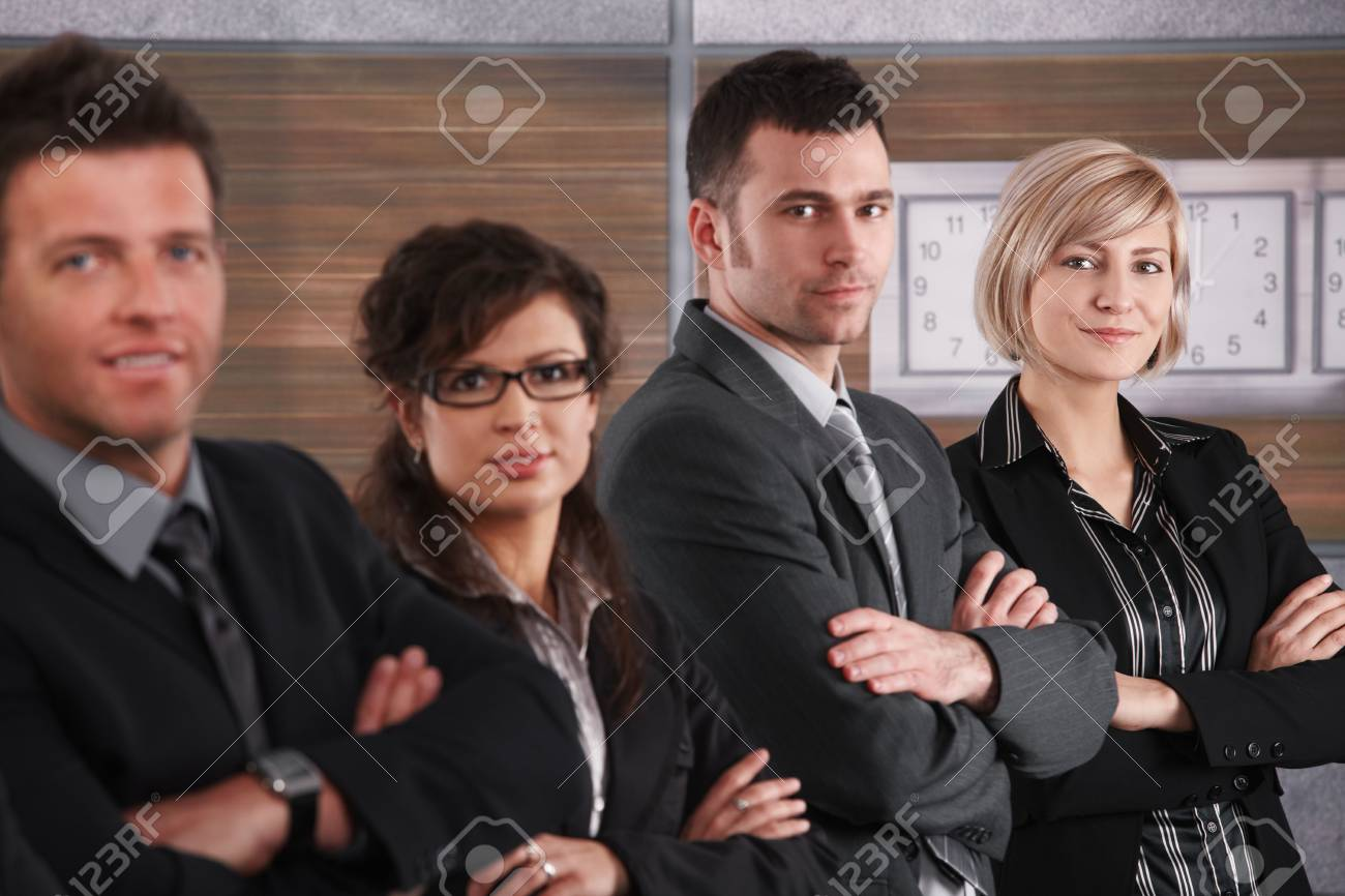 Portrait of businesswoman and team standing in a row on office corridor, smiling. Stock Photo - 6711671