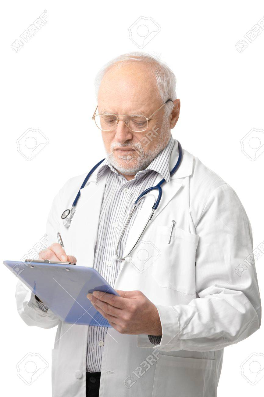 Serious senior doctor looking down at clipboard doing paperwork. Isolated on white background. Stock Photo - 6941512