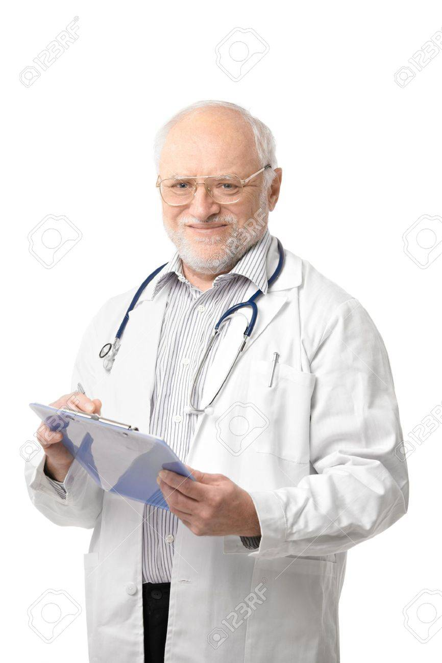 Portrait of happy senior doctor looking at camera, holding clipboard, smiling. Isolated on white background. Stock Photo - 6927316