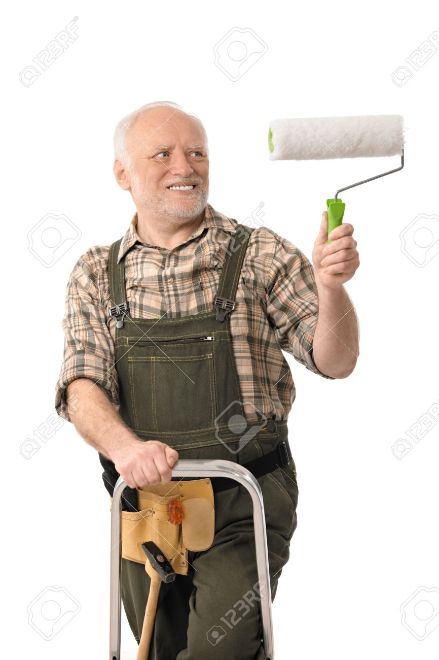 Do it yourself home renovation  elderly man standing on ladder painting  wall  Stock Photo. Do It Yourself Home Renovation  Elderly Man Standing On Ladder