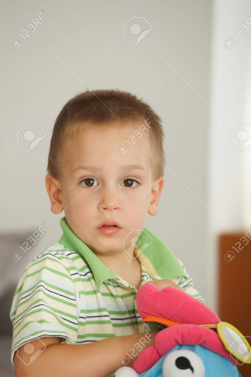 Portrait of little boy (3-4 years) looking at camera. Copyspace above. - 7058819