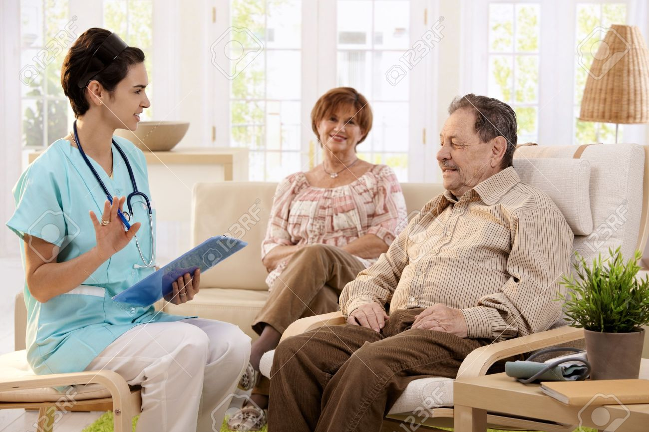 Nurse talking with elderly people and making notes during examination at home, smiling. Stock Photo - 7217419