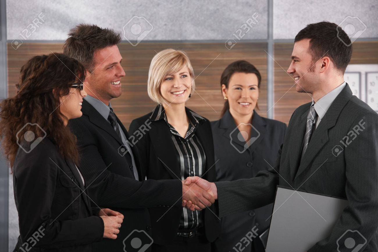 Happy business partners shaking hands in meeting room, smiling. Stock Photo - 7520467