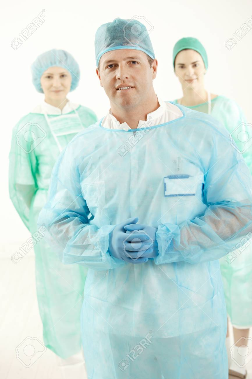 Portrait of doctor and two assistant in scrubs, looking at camera. Stock Photo - 7653604